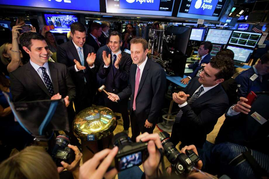 Matt Salzberg, co-founder and chief executive officer of Blue Apron, center, rings a ceremonial bell with Ilia Papas, co-founder and chief technology officer of Blue Apron, left; Tom Farley, president of the NYSE Group, second left; and Matthew Wadiak, co-founder, and chief operating officer of Blue Apron, center left, during the company's initial public offering on the floor of the New York Stock Exchangein New York on June 29. Photo: Bloomberg Photo By Michael Nagle. / Bloomberg