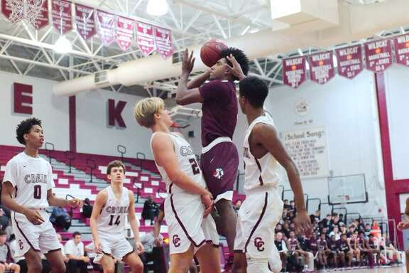 Pearland's Ovidio Perez puts up a jumper while Clear Creek's Hunter Smith defends Tuesday night in the Oilers' 59-50 victory. Perez shared game-high scoring honors with 17 points.