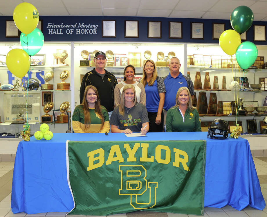 Friendswood's Kendall Cross has signed a national letter of intent to play softball for Baylor. Cross is joined by parents Terry and Elaine Cross, Kelsey Lawton and Friendswood coaches Christa Yates and Kevin Parr. Photo: Courtesy Photo