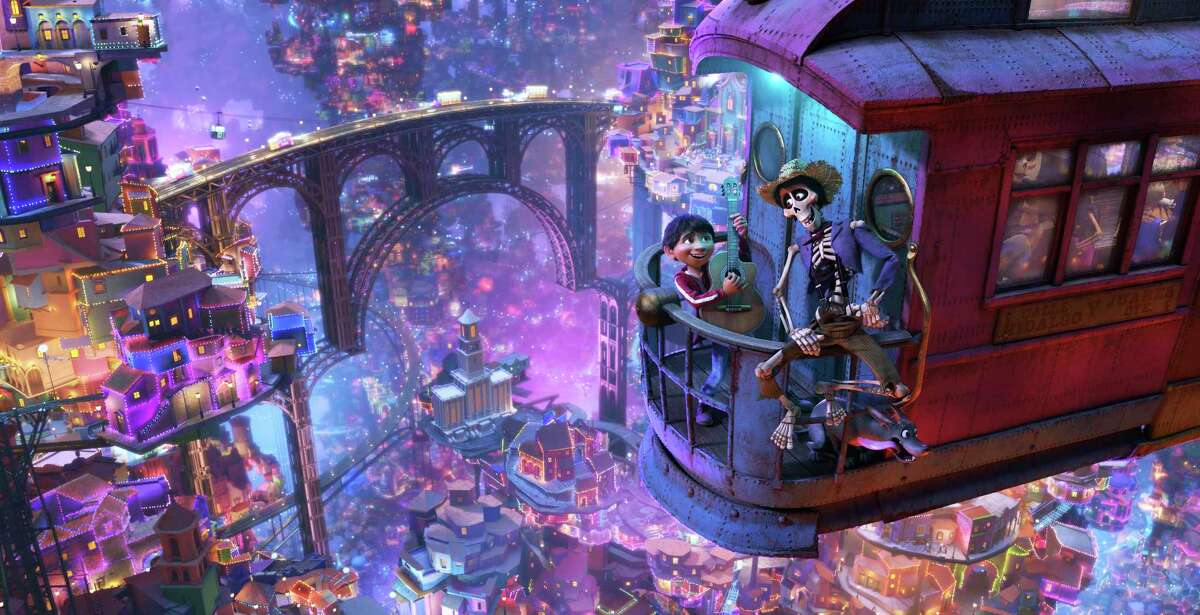 In this image released by Disney-Pixar, character Hector, voiced by Gael Garcia Bernal, right, and Miguel, voiced by Anthony Gonzalez, appear in a scene from the animated film,