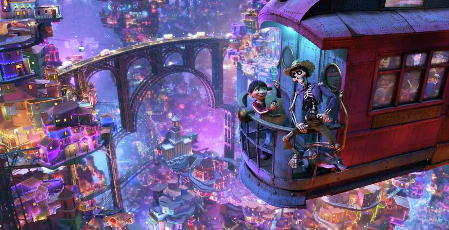 """In this image released by Disney-Pixar, character Hector, voiced by Gael Garcia Bernal, right, and Miguel, voiced by Anthony Gonzalez, appear in a scene from the animated film, """"Coco."""" (Disney-Pixar via AP) Photo: Pixar, HONS / © 2017 Disney•Pixar. All Rights Reserved."""