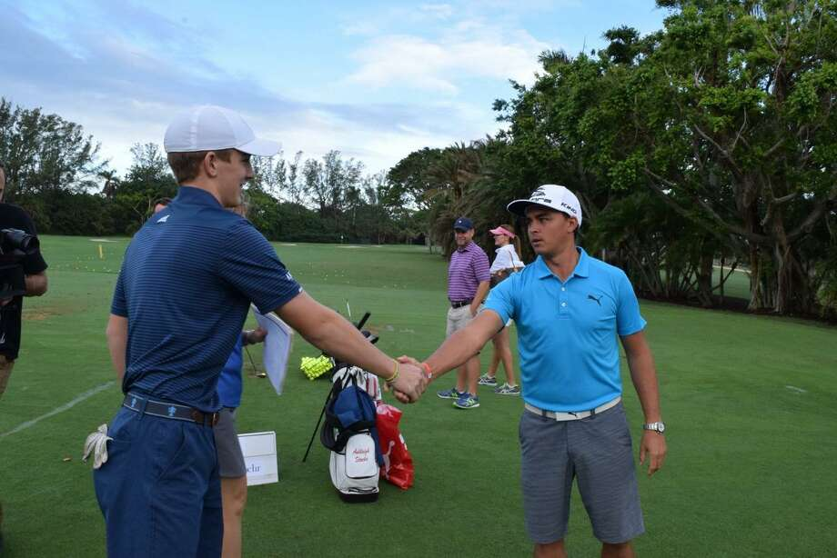 At left, St. Luke's student Jack Maguire shakes hands with professional golfer Rickie Fowler. Maguire raised almost $15,000 for charity. Photo: Contributed Photo / New Canaan News contributed