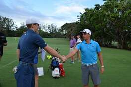 At left, St. Luke's student Jack Maguire shakes hands with professional golfer Rickie Fowler. Maguire raised almost $15,000 for charity.