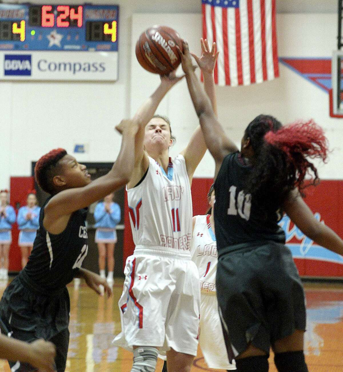 Lumberton's Megan Wilkinson looks for an opening to shoot inbetween Central's Tamya Renfro (left) and Alexis Cooper during the girls' district opener at Lumberton Tuesday. Photo taken Tuesday, December 5, 2017 Kim Brent/The Enterprise