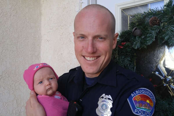 Albuquerque Police Officer Ryan Holets with his newborn baby, Hope.