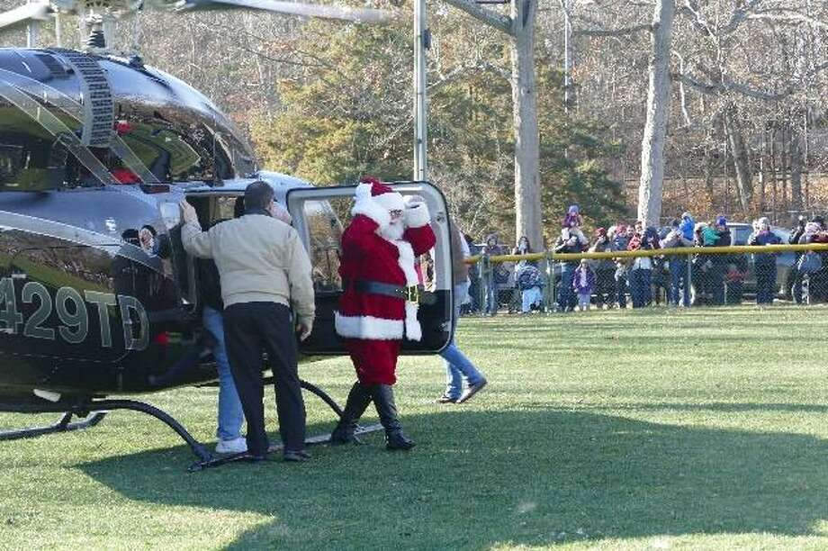 Santa will arrive at New Canaan by helicopter Saturday at Mead Park. Following the helicopter ride, Santa will be escorted in a firetruck to the Garden Center in Weed & Duryea. Find out more. Photo: Contributed Photo.