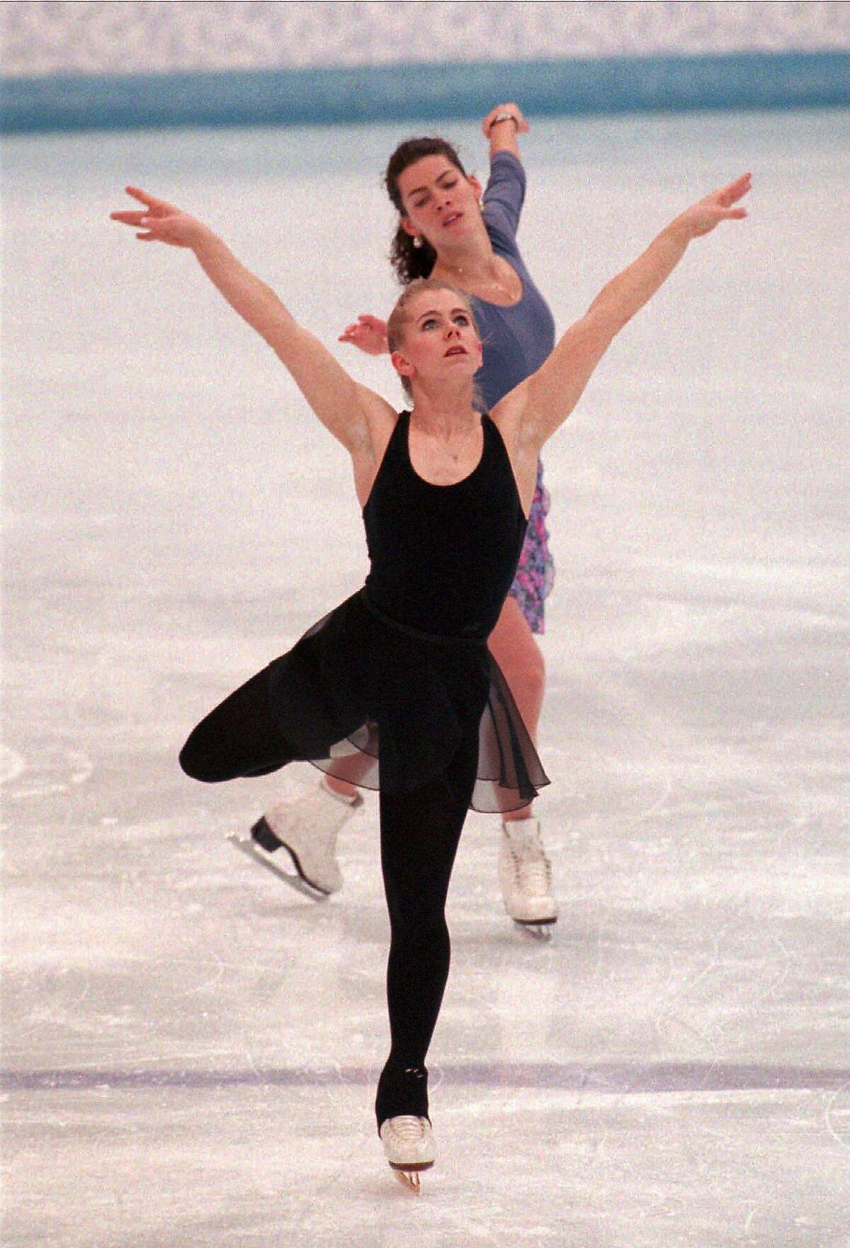 CHRONICLE 02/23/94 // American figure skaters Tonya Harding and Nancy Kerrigan, rear, skate through their routines during the practice session Tuesday, Feb. 22, 1994, at the Hamar Olympic Amphitheatre in Hamar, Norway. The women's technical program begins Wednesday evening.(AP Photo/Doug Mills)