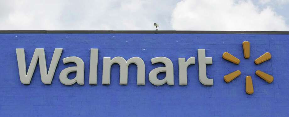 This June 1, 2017, file photo shows a Walmart store in Hialeah Gardens, Fla. Wal-Mart Stores Inc. is changing its legal name effective Feb. 1, 2018, to Walmart Inc. from Wal-Mart Stores Inc. Photo: Alan Diaz /Associated Press / Copyright 2017 The Associated Press. All rights reserved.