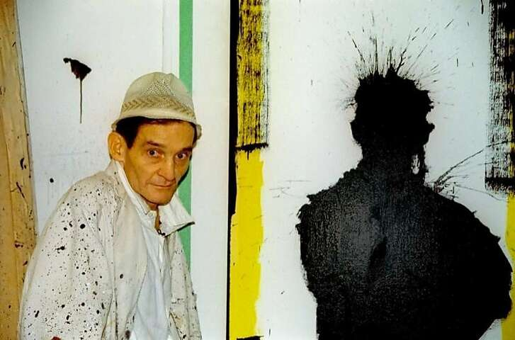 """The artist Richard Hambleton next to one of his """"shadow"""" paintings in Oren Jacoby's 2017 documentary """"Shadowman."""""""