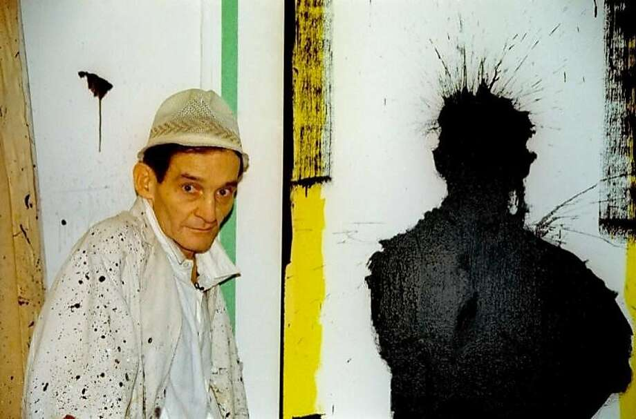 """The artist Richard Hambleton next to one of his """"shadow"""" paintings in Oren Jacoby's 2017 documentary """"Shadowman."""" Photo: Film Movement"""