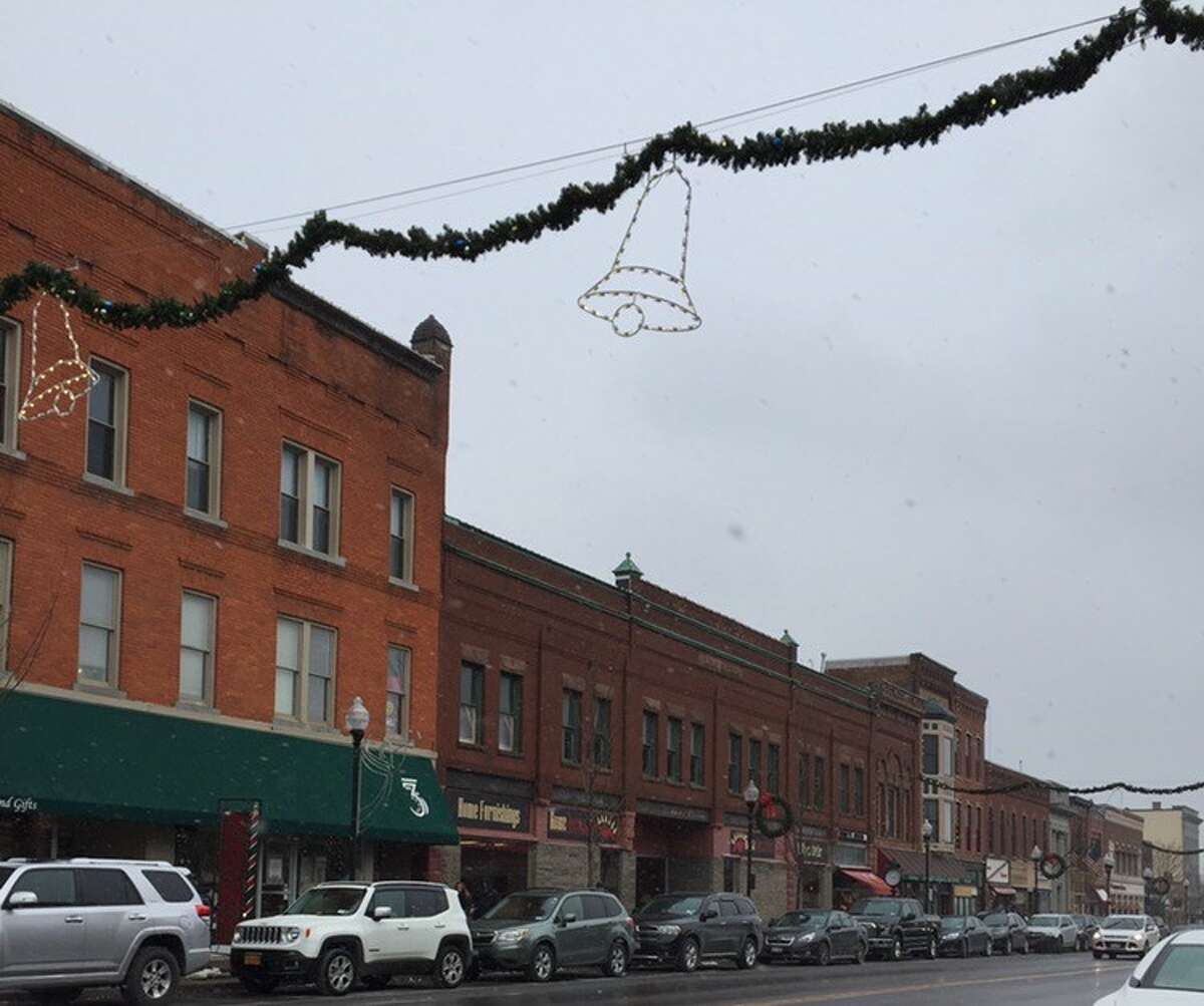 If snow was falling instead of rain, this string of storefronts and brownstones would look even more like Bedford Falls' main drag, Genesee Street.