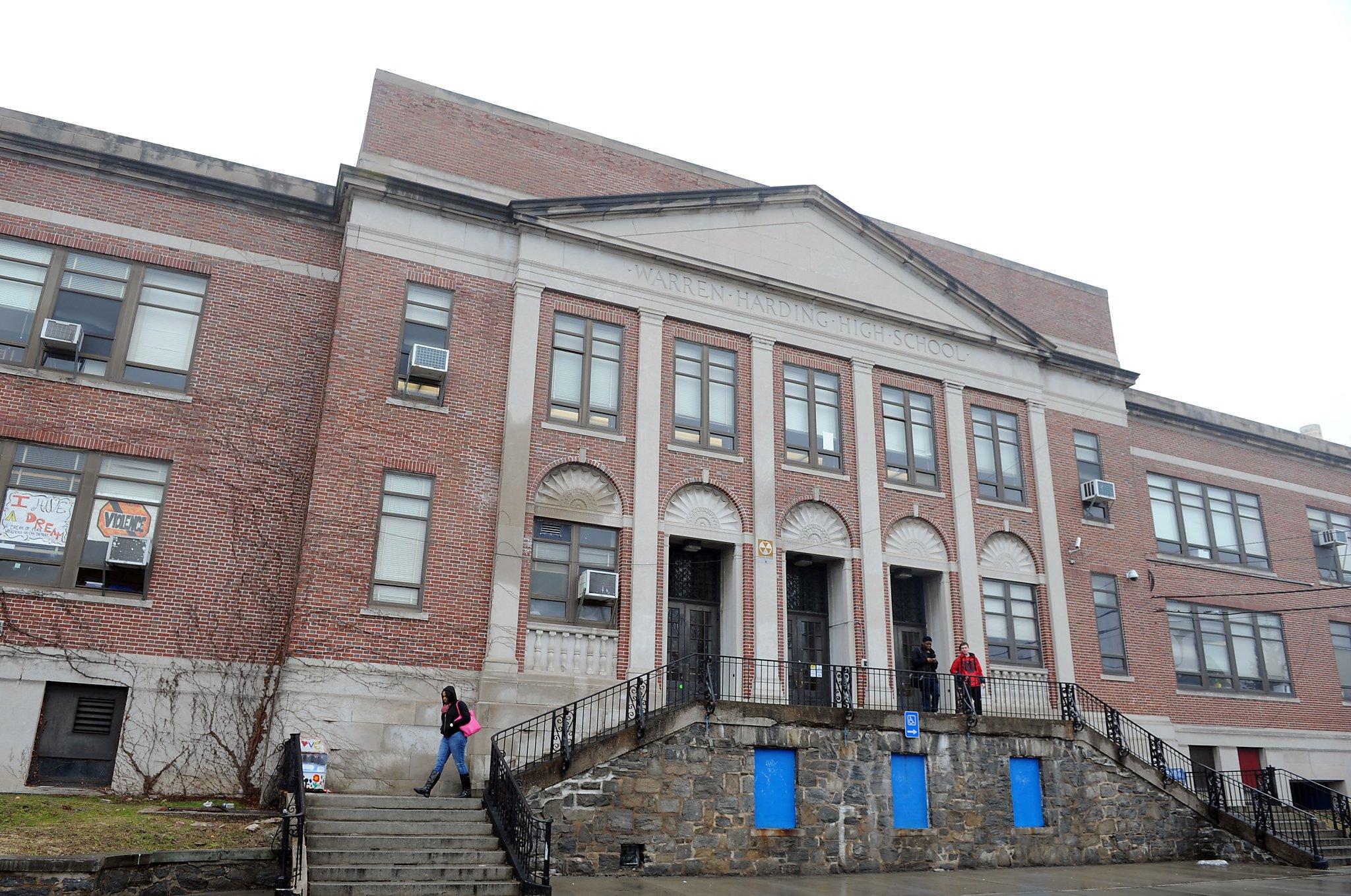 School employee accused of threatening white men killing spree