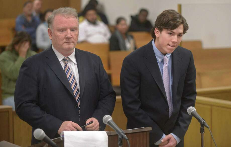 Darien High School student Brian Minicus, right, appears with his attorney Stephan Seeger Wednesday December 6, 2017, in Norwalk Superior Court in Norwalk, Conn. Two Darien teens were charged with the assault of a New Canaan minor. Brian Minicus, 18, and Jack Joyce, 18, turned themselves into New Canaan police on the night before the Turkey Bowl football game between Darien and New Canaan. Joyce was charged with disorderly conduct and interfering with an officer and Minicus was charged with third-degree assault and second-degree unlawful restraint after the two were allegedly involved in an altercation where a New Canaan teen was beaten up. Photo: Erik Trautmann / Hearst Connecticut Media / Connecticut Post