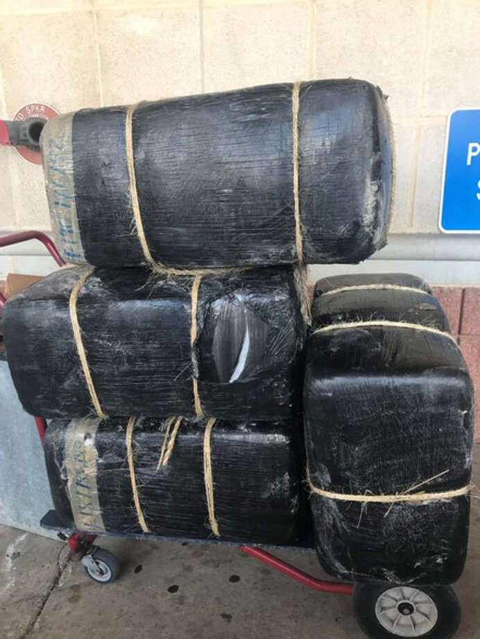 Laredo police said they seized the four bundles of marijuana shown in this photo. The contraband weighed about 287 pounds. Photo: Laredo Police Department/Courtesy Photo