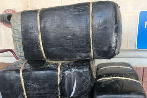 Laredo police said they seized the four bundles of marijuana shown in this photo. The contraband weighed about 287 pounds.