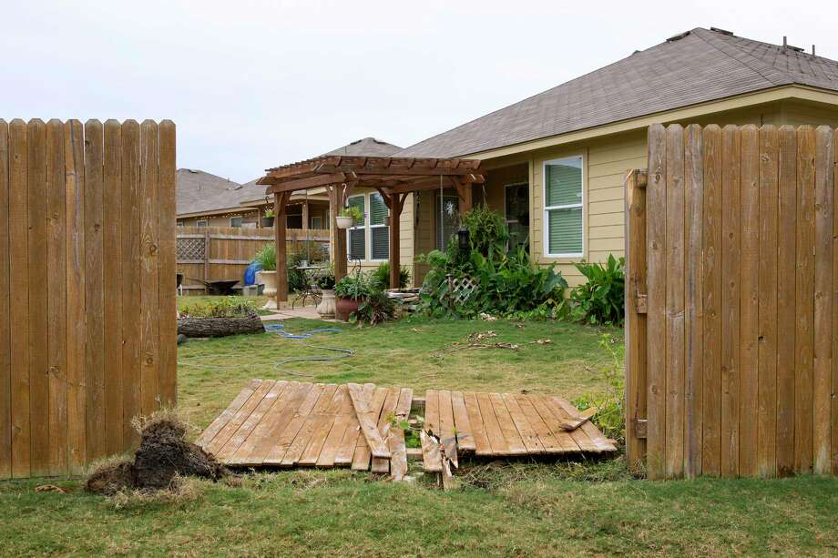 A section of fence remains down at the house on Valero Drive in San Marcos, Texas, on Tuesday Dec. 5, 2017, the day after San Marcos police officer Kenneth Copeland was killed attempting to serve a warrant there. (Jay Janner/Austin American-Statesman via AP) Photo: Jay Janner, Associated Press / Austin American-Statesman