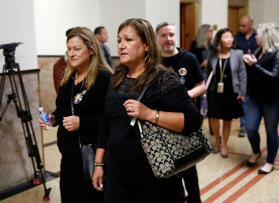 Maria Vega, (center) who lost her son Alex Vega in the fire returns to the courtroom after a break in the preliminary hearings in the case against Ghost Ship operator Derick Almena and creative director Max Harris in Alameda County Superior Court in Oakland, Calif. on Wednesday December 6, 2017. Photo: Michael Macor, The Chronicle