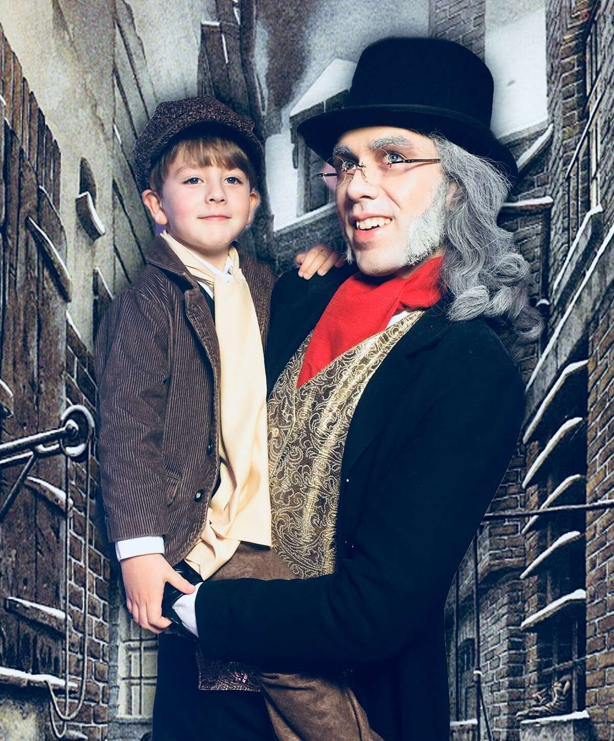 """Matthew Silvestro (left) plays Tiny Tim and Sean Salazar plays Scrooge in the Roxie Theatre's staging of """"A Christmas Carol."""""""