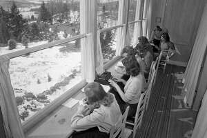 Evacuation plant of the Children's Foundation at New Milford, Conn., on March 17, 1941, built for American children in the event New York is threatened from the air. Girls do their homework, watching out of window. (AP Photo/Murray Becker)