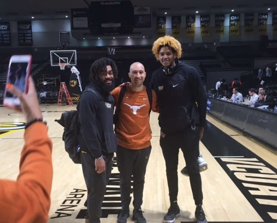 Shaka Smart with former players Johnny Williams and Justin Tillman. Photo: Washington Post Photo By Dan Steinberg. / The Washington Post