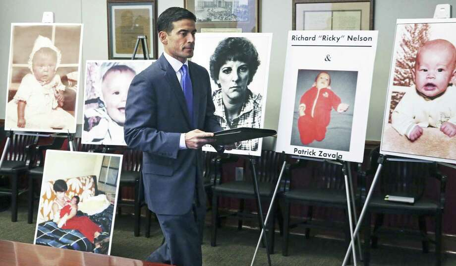 Walking in past photos of victims, District Attorney Nico LaHood announces his intentions to prosecute Genene Jones on December 6, 2017 Photo: Tom Reel, Staff / San Antonio Express-News / 2017 SAN ANTONIO EXPRESS-NEWS