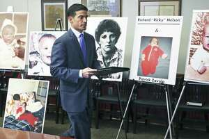 Walking in past photos of victims, District Attorney Nico LaHood announces his intentions to prosecute Genene Jones on December 6, 2017