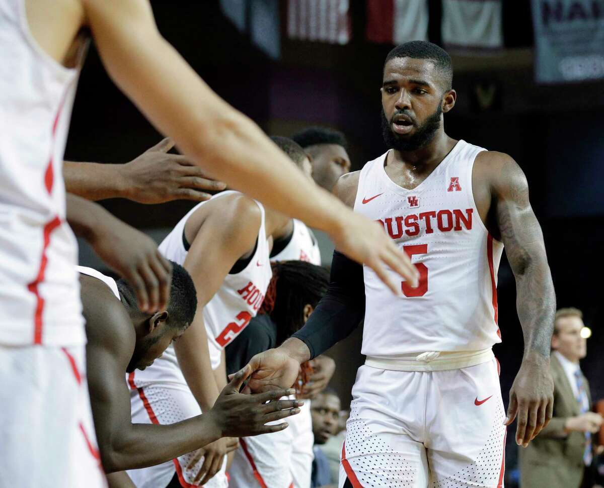 Houston guard Corey Davis Jr. (5) gets congrats as he heads to the bench with 16 points against Fairfield during the second half of their game played at HNPE Arena at Texas Southern University in Houston, TX, Dec. 6, 2017. (Michael Wyke / For the Chronicle)