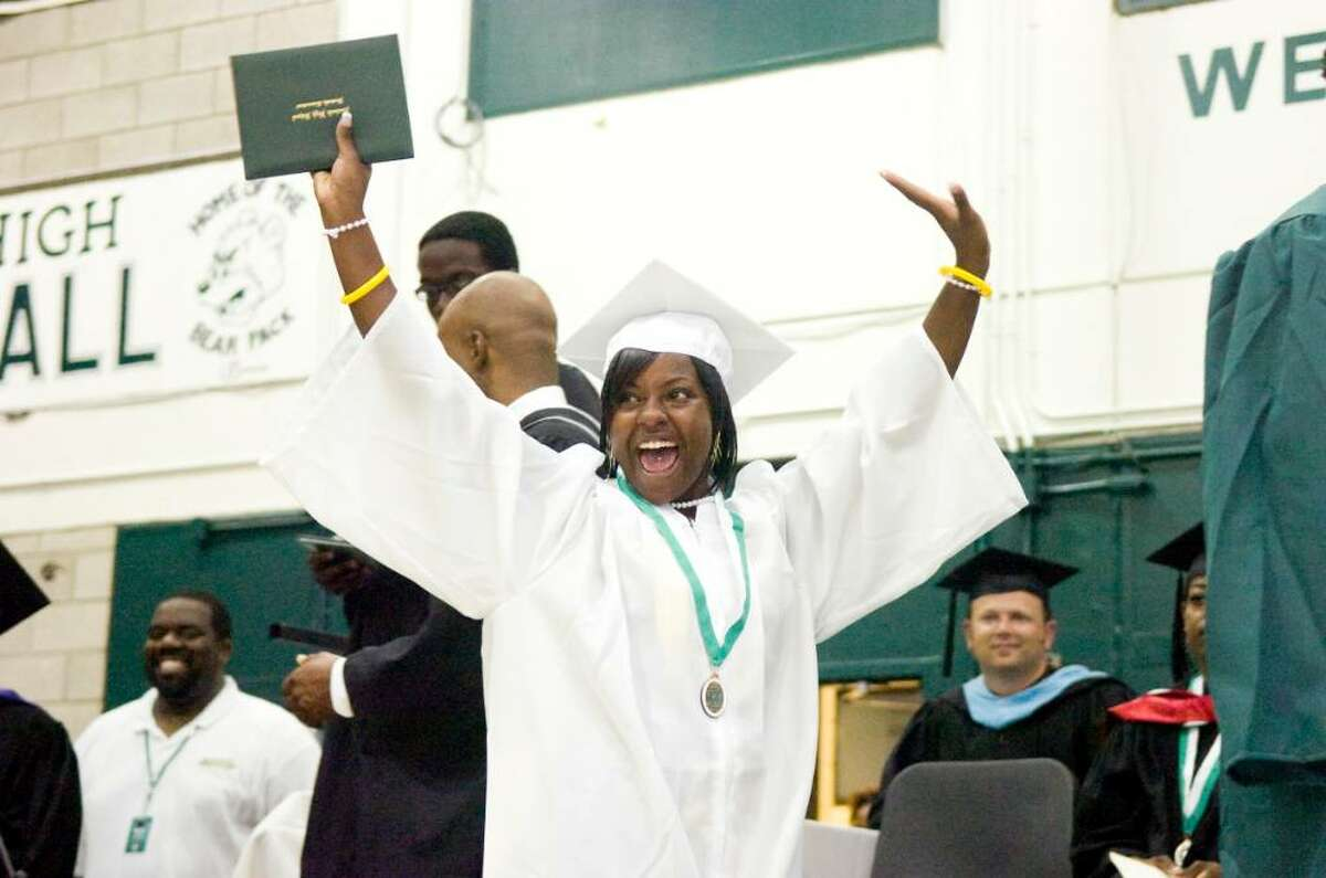 Leathia Lilia Johnson celebrates receiving her diploma during the Norwalk High School Class of 2010 graduation Monday, June 28, 2010.