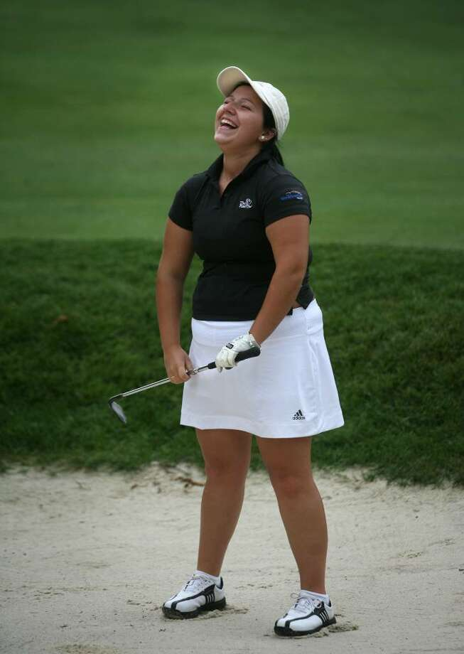 Monica Dias, 19 of Bridgeport, laughs after hitting a bunker shot during a J.J. Henry fundraising tournament at the Patterson Club in Fairfield on Monday, June 28, 2010. Dias and other Fairchild Wheeler First Tee participant players captained major company corporate teams from throughout the area. Photo: Brian A. Pounds / Connecticut Post