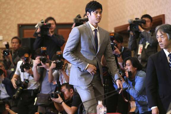 Japanese pitcher-outfielder Shohei Otani arrives for a press conference at Japanese National Press Center in Tokyo, Saturday, Nov. 11, 2017. Highly touted Japanese pitcher-outfielder Shohei Otani announced on Saturday he wants to move to Major League Baseball next season. (AP Photo/Koji Sasahara)