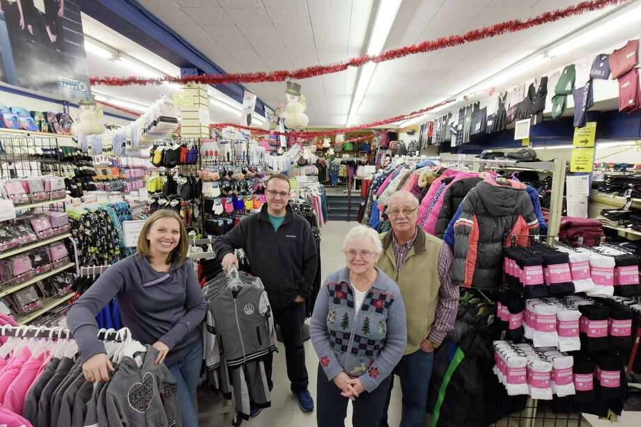 Yonally family members, Sharon Freddoso, left, her brother Mark Yonally and their parents, Elaine Yonally and Jack Yonally pose for a photo in the children's department in B. Lodge and Co. on Wednesday, Dec. 6, 2017, in Albany, N.Y.  The store is celebrating 150 years in business this year.  Elaine and Jack Yonally bought the store in 1995.  Sharon and Mark now run the store.   (Paul Buckowski / Times Union) Photo: PAUL BUCKOWSKI, Albany Times Union / 20042326A