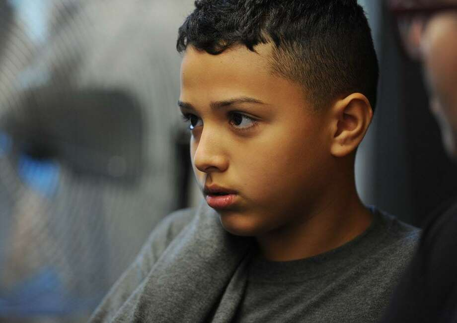 Hartford School District: 291 students displaced as of 12-1-17Pictured: Juan Casiano, 12, from Bayamon, Puerto Rico, at City Hall in Bridgeport, Conn. on Thursday, October 5, 2017. Casiano and his brother, who are staying with Bridgeport relatives following the devastating hurricane in Puerto Rico, will begin attending Luis Munoz Marin School next week. Photo: Brian A. Pounds / Hearst Connecticut Media / Connecticut Post
