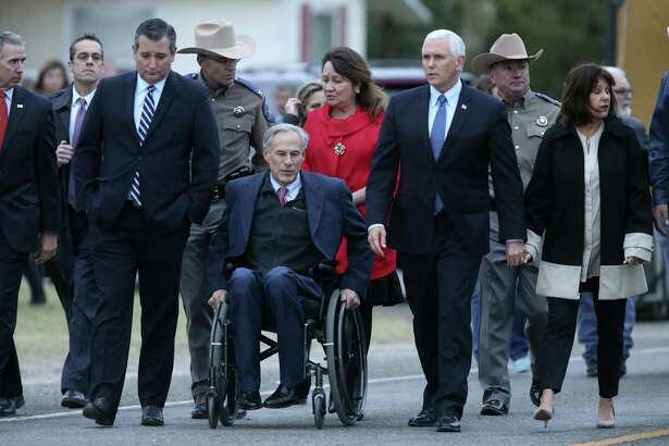 U. S. Vice President Mike Pence and Texas Gov. Greg Abbott walk to address the media after visiting the Sutherland Springs, Texas First Baptist Church, Wednesday, Nov. 8, 2017. With them are their spouses, Karen Pence and Cecilia Abbott. At left is U.S. Sen. Ted Cruz.