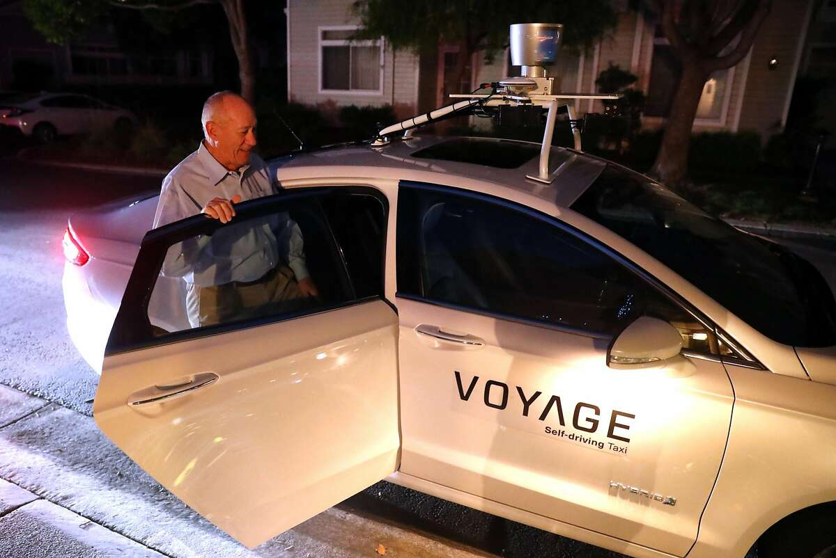 Villages Golf & Country Club resident Jerry Neece gets in a Voyages robot taxi service in San Jose on November 22, 2017.