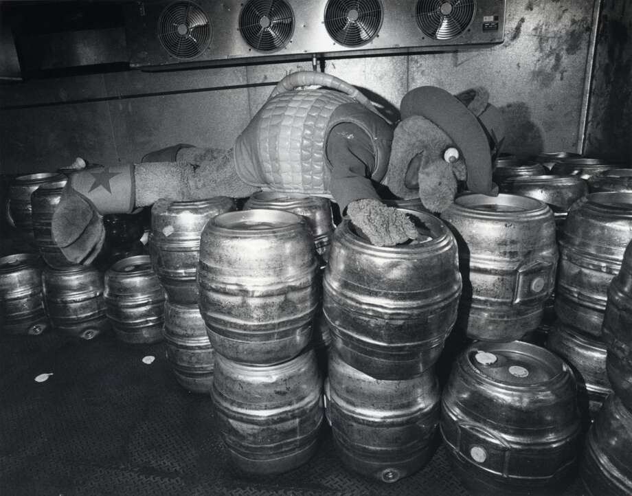 Houston Astros mascot  Astrodillo lays on some beer kegs at the Astrodome in April 1983. He later got the help he needed. Photo: Audrey Ueckert/Houston Chronicle