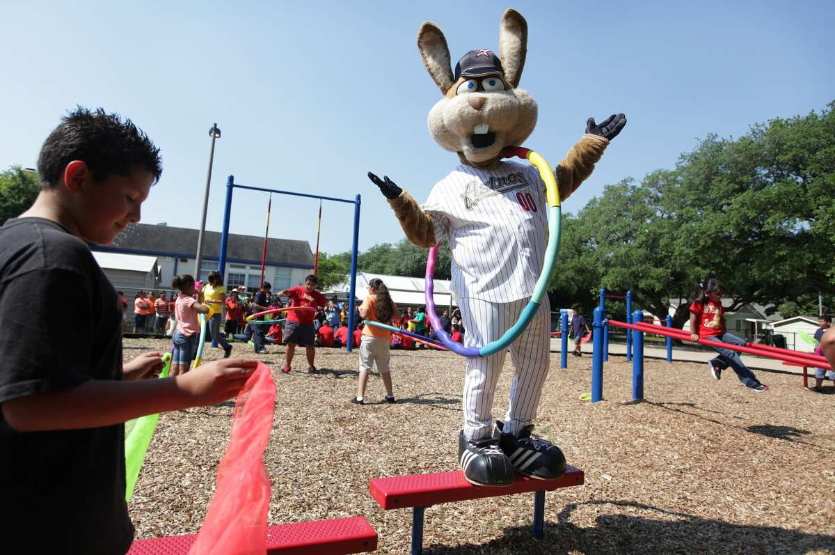 Astros' Junction Jack cheers after climbing a couple of steps during the launch of the new Project Fit America fitness playground at Eugene Field Elementary School on Thursday, May 17, 2012, in Houston. Just months later he would be retired and Orbit would return to the Astros family.