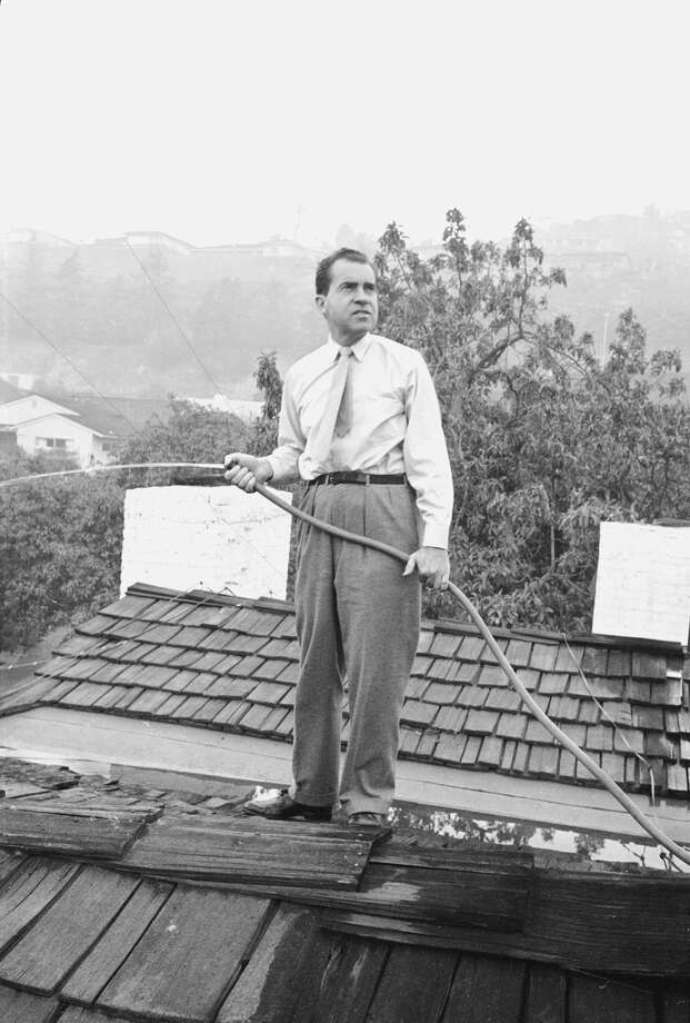 FILE — Senator Richard M. Nixon on roof of home in Los Angeles, putting out fires caused by brush blaze. Los Angeles, California 1961 Photo: Allan Grant/The LIFE Picture Collection/Getty Images