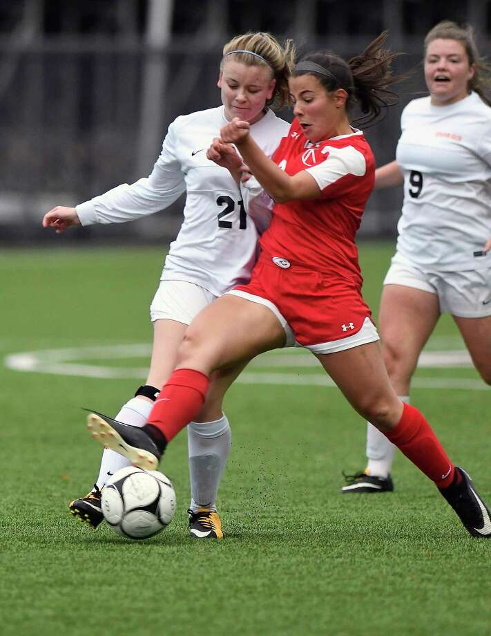 Bethlehem's Sydney Smith (21) challenges  Niskayuna's  Isabelle Lynch (2) for the ball during a Section II Class AA girls' high school semifinal soccer game in Troy, N.Y., Thursday, Oct. 26, 2017. Niskayuna won the game 2-1 in overtime. (Hans Pennink / Special to the Times Union) ORG XMIT: HP112 Photo: Hans Pennink / Hans Pennink