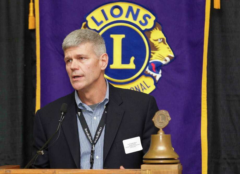 College Park head coach Clifton McNeely speaks during the Conroe Noon Lions Club's annual Roundball Roundup with area boys basketball coaches at the Lone Star Convention & Expo Center, Wednesday, Dec. 6, 2017, in Conroe. Photo: Jason Fochtman, Staff Photographer / © 2017 Houston Chronicle