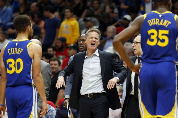 Golden State Warriors head coach Steve Kerr calls out to hist team from the bench in the second half of an NBA basketball game against the New Orleans Pelicans in New Orleans, Monday, Dec. 4, 2017. The Warriors won 125-115. (AP Photo/Gerald Herbert)