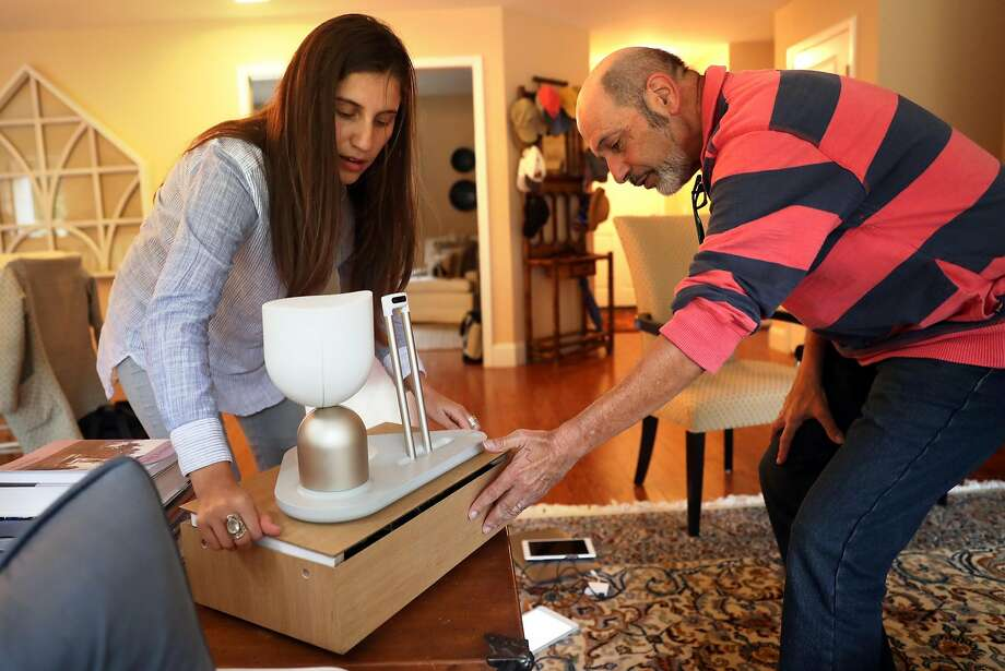 Intuition Robotics User Researcher Danielle Ishak sets up ElliQ at Barry Sardis' residence in San Jose. Sardis will be testing out the robot. Photo: Scott Strazzante, The Chronicle