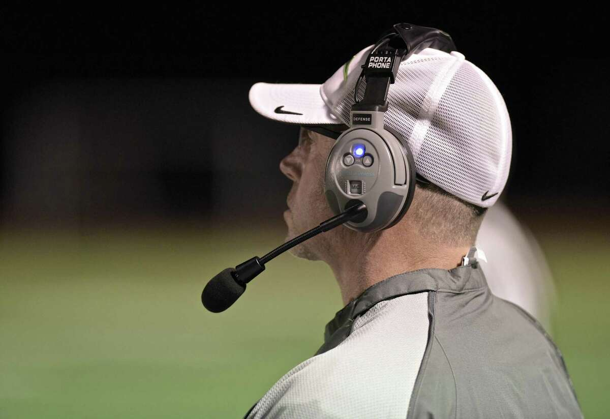 New Milford head coach Larry Badaracco watches his team during the high school football game between New Milford and Joel Barlow high schools on Friday night, October 6, 2017, at Joel Barlow High School, in Redding, Conn.