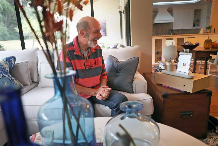 Barry Sardis tests ElliQ, a robot built to improve the quality of senior citizens' lives, last month at his residence in San Jose. Photo: Scott Strazzante, The Chronicle