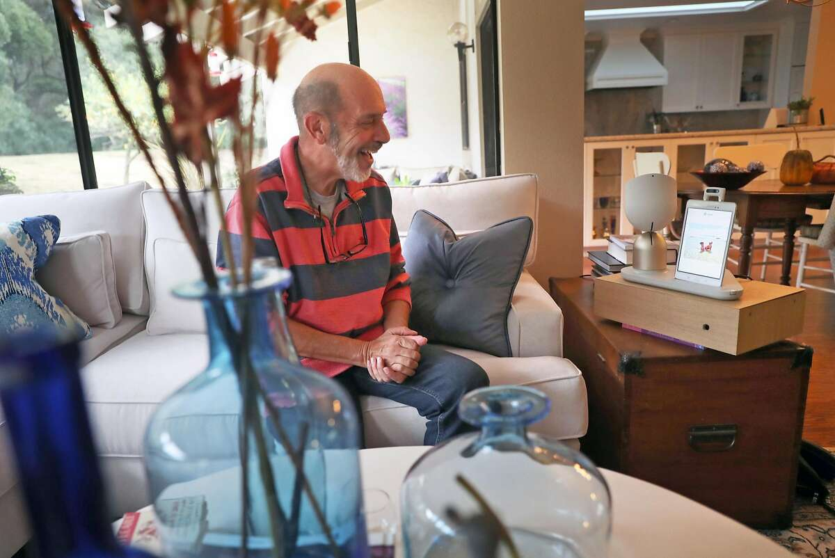 Barry Sardis tests ElliQ, after receiving the robot built to improve the quality of senior citizen's lives, at his residence in San Jose, Calif., on Monday, November 20, 2017.