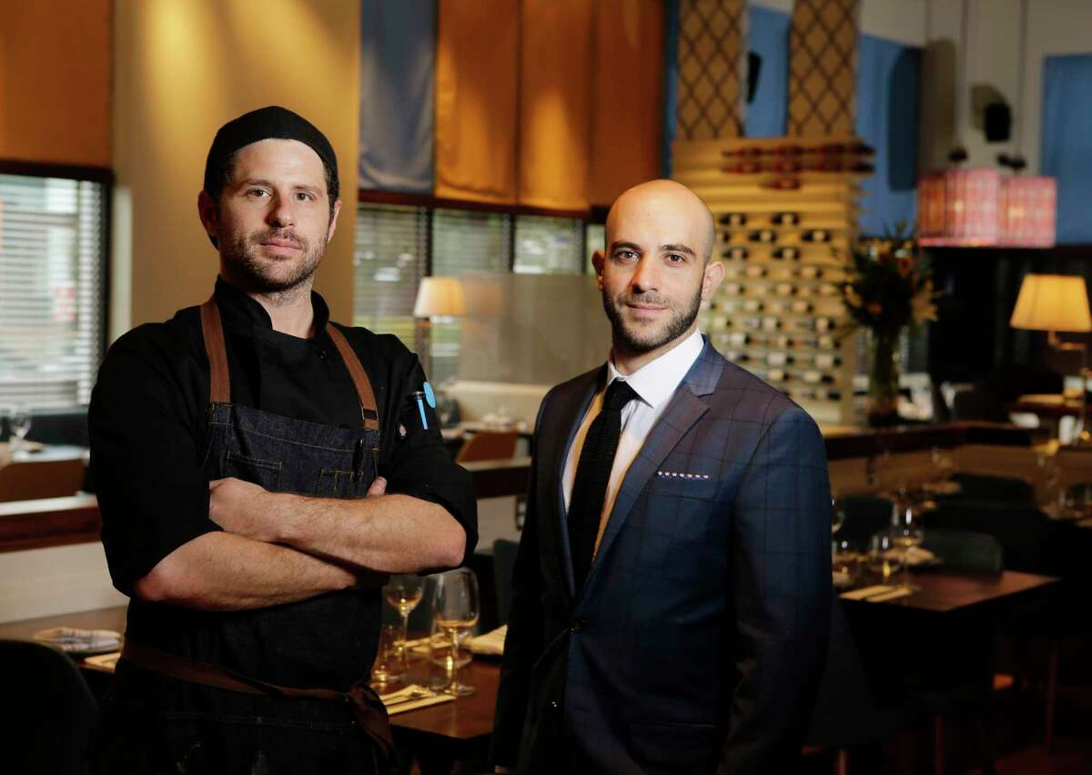 Chef-partner Sash Kurgan, left, and managing partner Itai Ben Eli, right, at Doris Metropolitan in Houston.