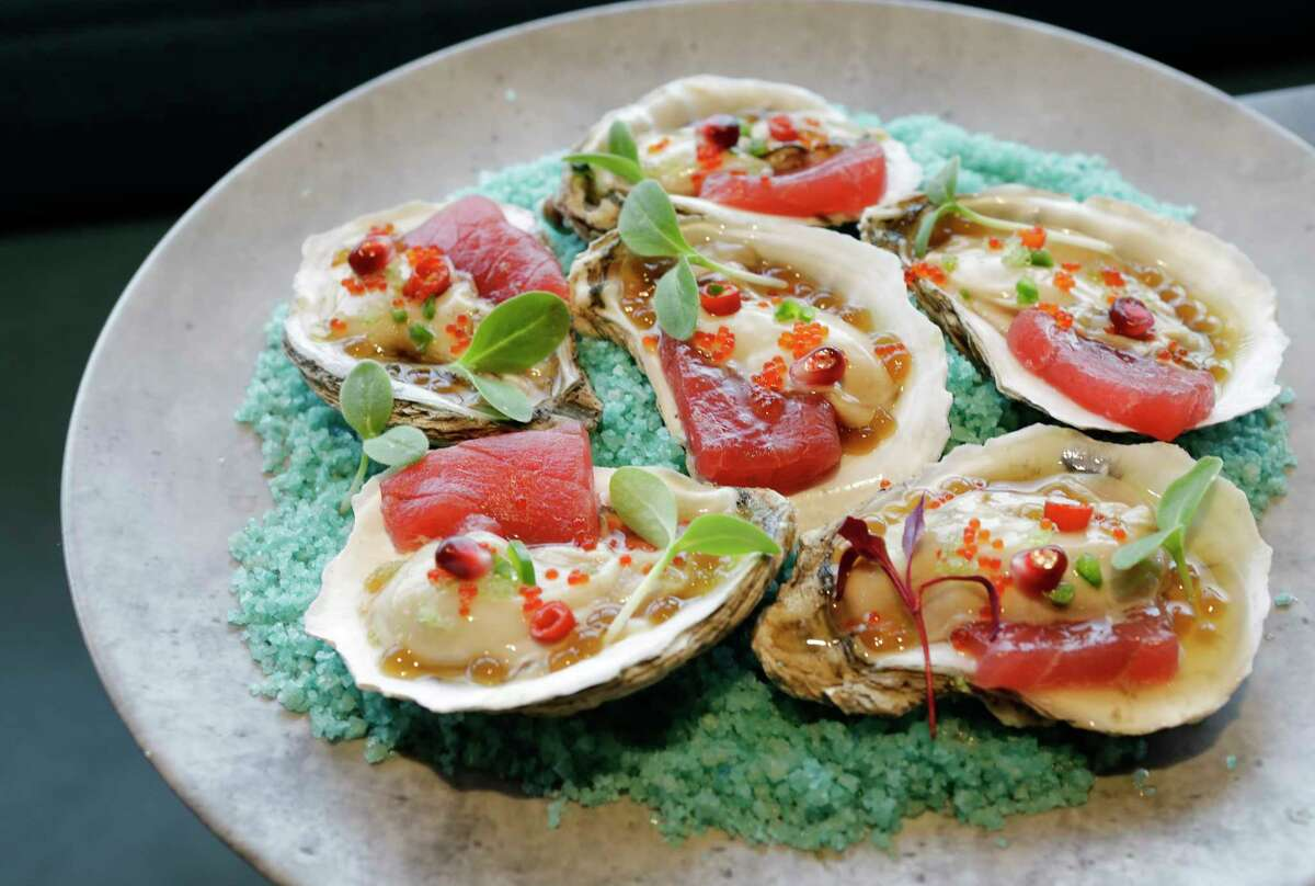 Sing Sing oysters topped with tuna and fish sauce
