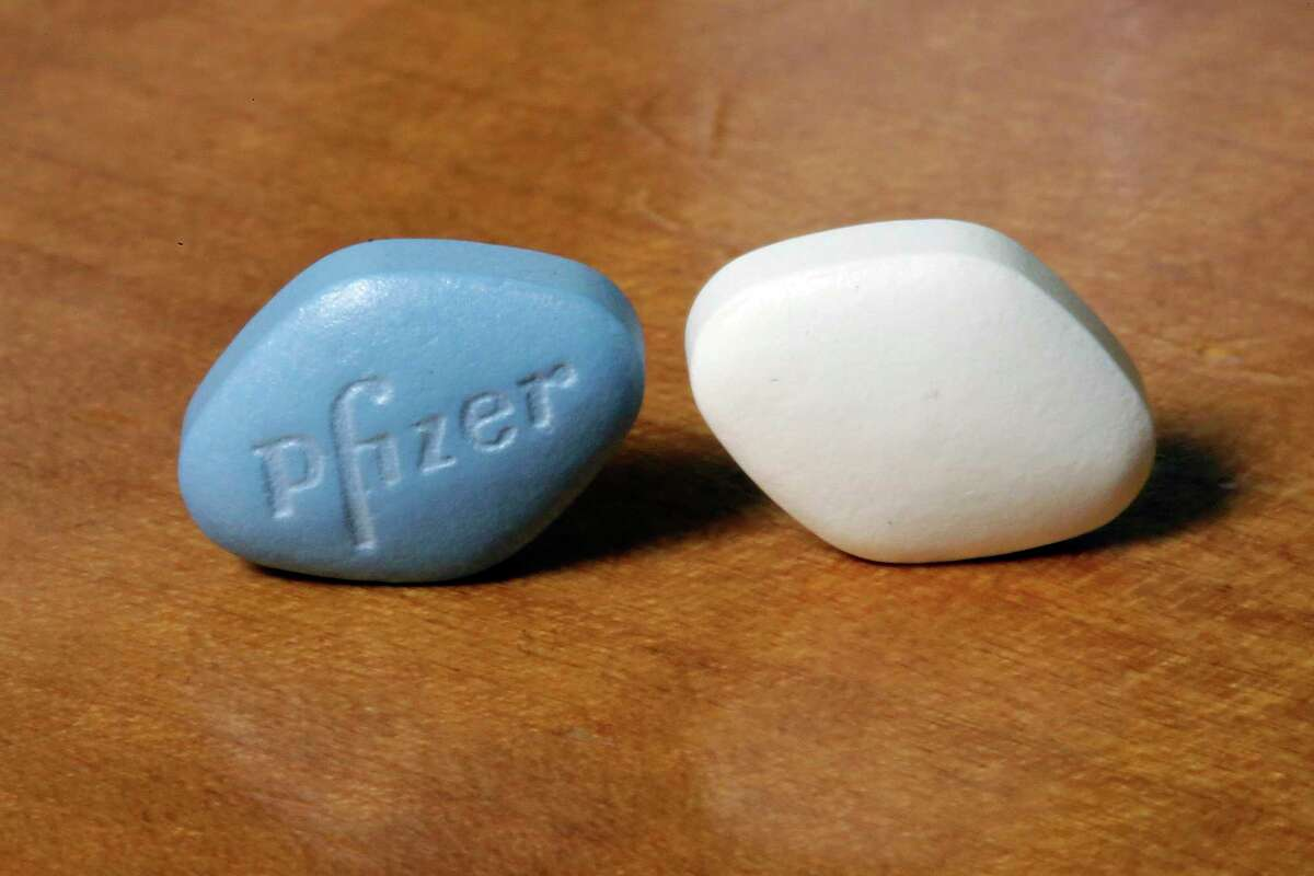 This Monday, Dec. 4, 2017 photo shows a tablet of Pfizer's Viagra, left, and the company's generic version, sildenafil citrate, at Pfizer Inc., headquarters in New York. The drugmaker is launching its own cheaper generic version of Viagra rather than lose sales when its impotence pill gets its first generic competition. (AP Photo/Richard Drew)