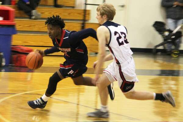 Plainview guard Josh Hines dribbles past Trinity Christian's Travis Parker, 23, during a game in Lubbock Tuesday night. Hines scored 15 points and pulled down five rebounds to help the Bulldogs to a victory.