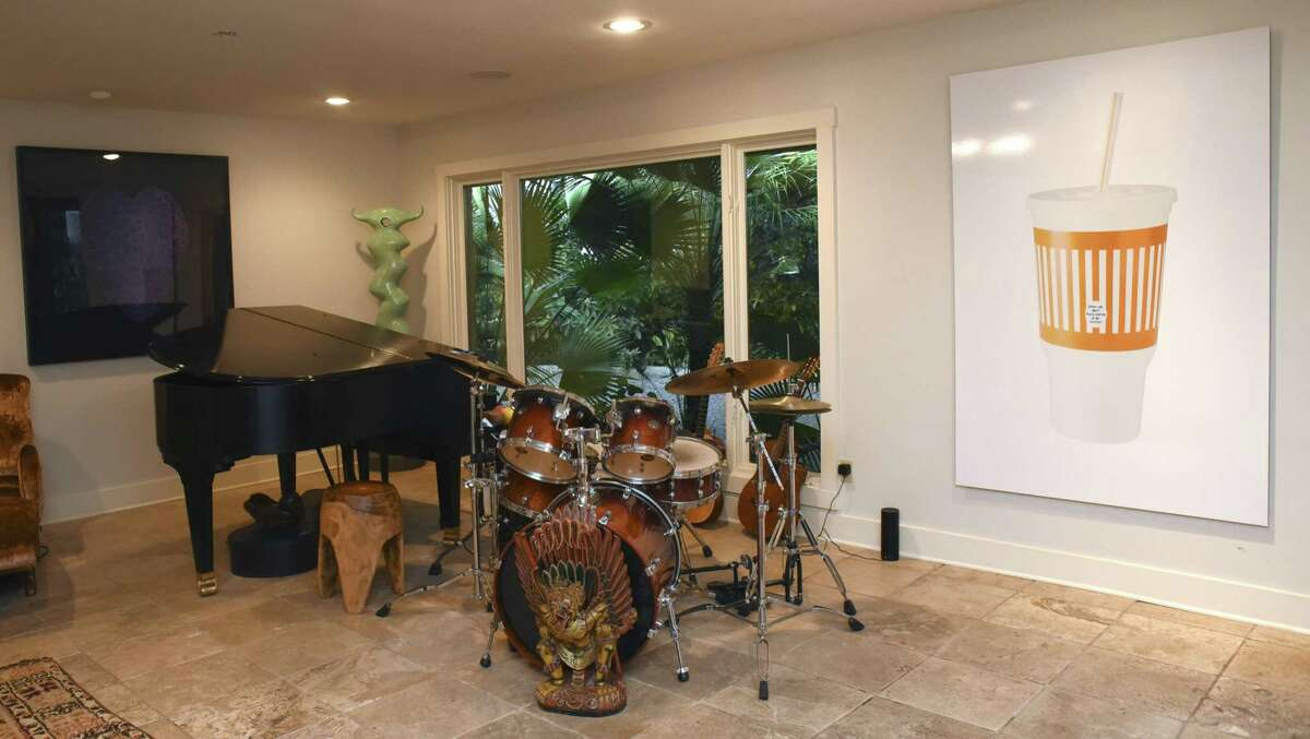 """Just right of the front door of the Olmos Park home where Ana Montoya and Gobie Walsdorf live is a """"music room"""" with a drum set and piano. """"My whole family is musical, mainly jazz and blues,"""" Walsdorf said."""