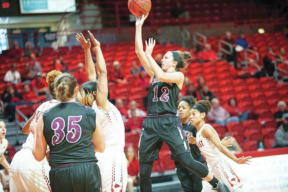 SIUC freshman Makenzie Silvey (No. 12) goes up for a shot during a game against SEMO on Nov. 22 in Cape Girardeau, Mo. Silvey is the No. 2 all-time leading scorer at Edwardsville.
